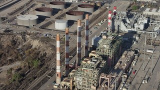 AX64_0039 - 5K stock footage aerial video of smoke stacks at the LADWP Valley Generating Station in Sun Valley, California