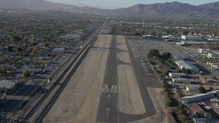 AX64_0042 - 5K stock footage aerial video of descending toward the runway at Whiteman Airport, Pacoima California