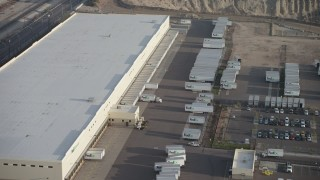 AX64_0045 - 5K stock footage aerial video of a Fed-Ex warehouse in Pacoima, California