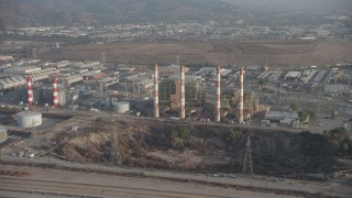 AX64_0050 - 5K stock footage aerial video of LADWP Valley Generating Station and smoke stacks, Sun Valley, California