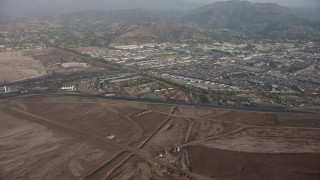 AX64_0052 - 5K stock footage aerial video of car junkyard and warehouse buildings in Sun Valley, California