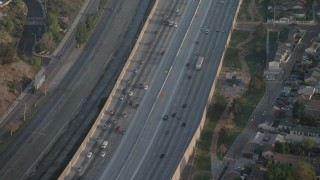 AX64_0057 - 5K stock footage aerial video of bird's eye of light traffic on Interstate 5 freeway, Burbank, California