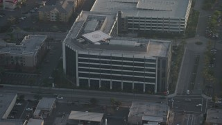 AX64_0061 - 5K stock footage aerial video approach and tilt to an office building in Burbank, California