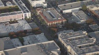AX64_0064 - 5K stock footage aerial video flyby office buildings and stores in Burbank, California