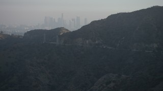 AX64_0069 - 5K stock footage aerial video of the hazy Downtown Los Angeles skyline in California