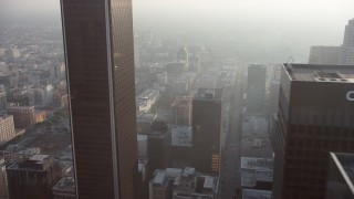 AX64_0088 - 5K stock footage aerial video flyby Downtown Los Angeles skyscrapers in haze, California