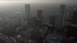AX64_0089 - 5K stock footage aerial video of haze-shrouded skyscrapers in Downtown Los Angeles, California