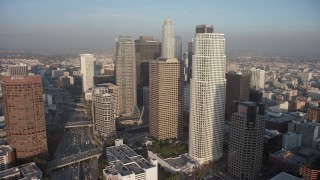 AX64_0093 - 5K stock footage aerial video approach tall skyscrapers in Downtown Los Angeles, California