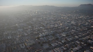 AX64_0112 - 5K stock footage aerial video fly over neighborhoods in East Hollywood and approach Hollywood Sign, Los Angeles, California, Sunset