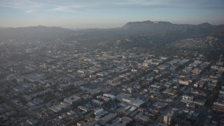AX64_0113 - 5K stock footage aerial video of urban neighborhoods and the Hollywood Sign, East Hollywood, Los Angeles, California, sunset