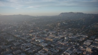 AX64_0114 - 5K stock footage aerial video urban residential neighborhoods in East Hollywood and the Hollywood Sign, Los Angeles, California, sunset