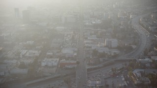 AX64_0115 - 5K stock footage aerial video follow Hollywood Boulevard in Los Angeles, California, sunset