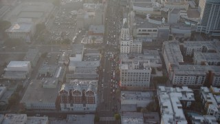 AX64_0118 - 5K stock footage aerial video of malls and theaters on Hollywood Boulevard, Hollywood, California, Sunset