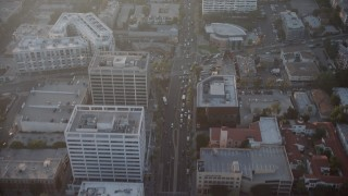 AX64_0119 - 5K stock footage aerial video of apartment and office buildings on Hollywood Boulevard, Hollywood, California, sunset