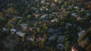 AX64_0124 - 5K stock footage aerial video fly over hillside homes in Hollywood Hills, California, sunset