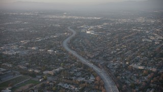 AX64_0129 - 5K stock footage aerial video of Highway 170 and North Hollywood suburbs, California, sunset