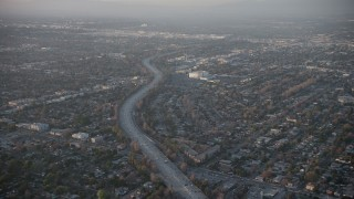 AX64_0130 - 5K stock footage aerial video of following Highway 170 through North Hollywood suburbs, California, sunset