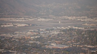 AX64_0131 - 5K stock footage aerial video of Bob Hope International Airport in Burbank, California, sunset