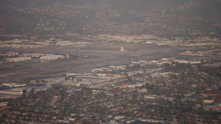 AX64_0132 - 5K stock footage aerial video flyby Bob Hope International Airport, Burbank, California, sunset