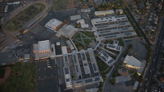 AX64_0136 - 5K stock footage aerial video of Francis Polytechnic Senior High school in Sun Valley, California sunset