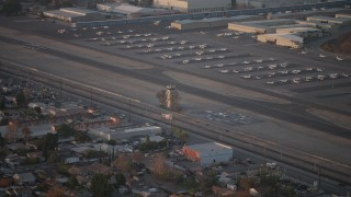 AX64_0138 - 5K stock footage aerial video of airport control tower at Whiteman Airport, Pacoima California, sunset