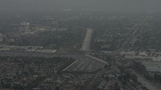 AX64_0146 - 5K stock footage aerial video of Highway 170, suburban homes, and large parking lot, North Hollywood, California, sunset