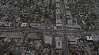 AX64_0152 - 5K stock footage aerial video bird's eye of suburban neighborhoods and busy streets in Van Nuys, California, twilight
