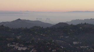 AX64_0157 - 5K stock footage aerial video of Century City high-rises and Hollywood Hills mansions, California, twilight