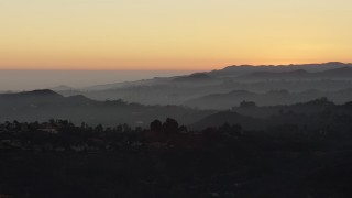 AX64_0160 - 5K stock footage aerial video of hilltop mansions in the Hollywood Hills, Los Angeles, California, twilight
