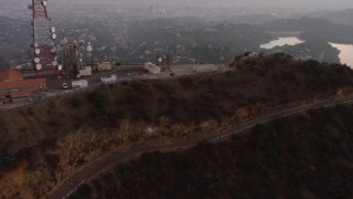AX64_0165 - 5K stock footage aerial video flyby the radio tower above Hollywood Sign, Los Angeles, California, twilight