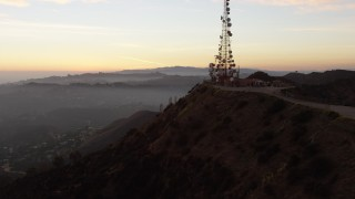 AX64_0166 - 5K stock footage aerial video flyby the radio tower to reveal the Hollywood Sign, Los Angeles, California, twilight