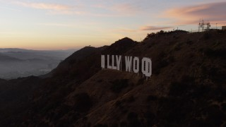 AX64_0167 - 5K stock footage aerial video flyby the Hollywood Sign at twilight, Los Angeles, California