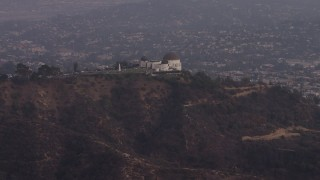 AX64_0169 - 5K stock footage aerial video approach the Griffith Observatory at twilight, Los Angeles, California