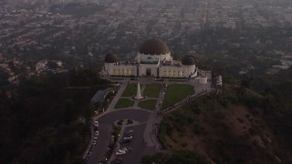 AX64_0171 - 5K stock footage aerial video flyby the north side of Griffith Observatory, Los Angeles, California, twilight