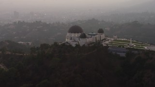 AX64_0172 - 5K stock footage aerial video flyby the east side of the Griffith Observatory, Los Angeles, California, twilight