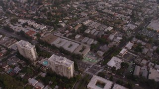 AX64_0174 - 5K stock footage aerial video of apartment buildings and urban homes, Los Feliz, California, twilight
