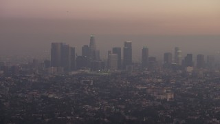 AX64_0176 - 5K stock footage aerial video of the Downtown Los Angeles skyline in haze, California, twilight