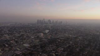 AX64_0180 - 5K stock footage aerial video of Downtown Los Angeles, Echo Lake, and city sprawl in haze, California, twilight