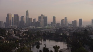 AX64_0183 - 5K stock footage aerial video fly over Echo Lake to approach Downtown Los Angeles at twilight, California