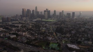 AX64_0185 - 5K stock footage aerial video approach Downtown Los Angeles skyline in haze, California, twilight