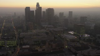 AX64_0189 - 5K stock footage aerial video of Downtown Los Angeles skyscrapers behind concert halls at twilight, California