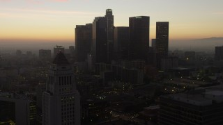 AX64_0191 - 5K stock footage aerial video flyby Downtown Los Angeles and City Hall, California, twilight