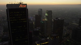 AX64_0196 - 5K stock footage aerial video flyby Aon Center to reveal skyscrapers and Staples Center in Downtown Los Angeles, California, twilight
