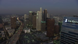 AX64_0205 - 5K stock footage aerial video flyby Ritz-Carlton hotel to reveal Downtown Los Angeles skyscrapers, California, twilight