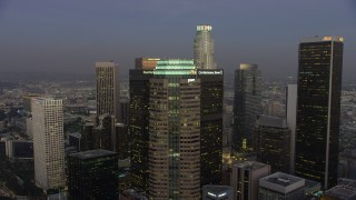 AX64_0207 - 5K stock footage aerial video flyby Figueroa at Wilshire skyscraper in Downtown Los Angeles, California, twilight