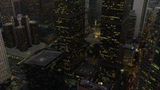 AX64_0208 - 5K stock footage aerial video flyby skyscrapers to reveal the public library and 5th Street in Downtown Los Angeles, California, twilight