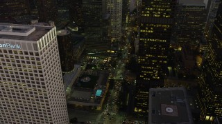 AX64_0209 - 5K stock footage aerial video of Public Library, Union Bank Plaza, and the Westin Bonaventure in Downtown Los Angeles, California, twilight