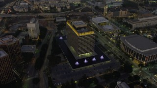 AX64_0211 - 5K stock footage aerial video of the LADWP office building and concert halls, Downtown Los Angeles, California, twilight