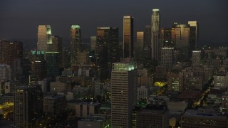 AX64_0228 - 5K stock footage aerial video of Downtown Los Angeles skyscrapers reflecting the twilight light, California