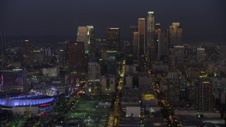 AX64_0232 - 5K stock footage aerial video of Downtown Los Angeles skyscrapers and reveal Staples Center arena, California, twilight